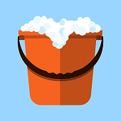 Red cleaning bucket with soap bubbles