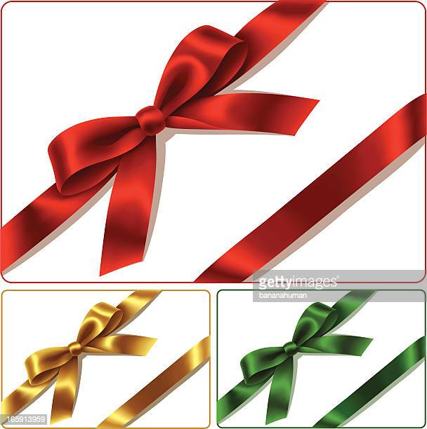 Red golden and green bows isolated on white background