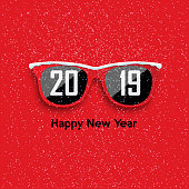 Red hipster glasses on snowfall background.