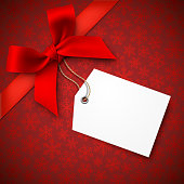 Red Holiday Background with Red Bow and Tag