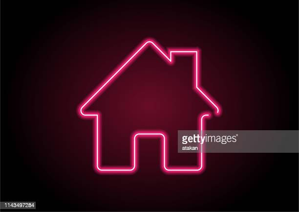 red home icon neon light on black wall - domestic life stock illustrations