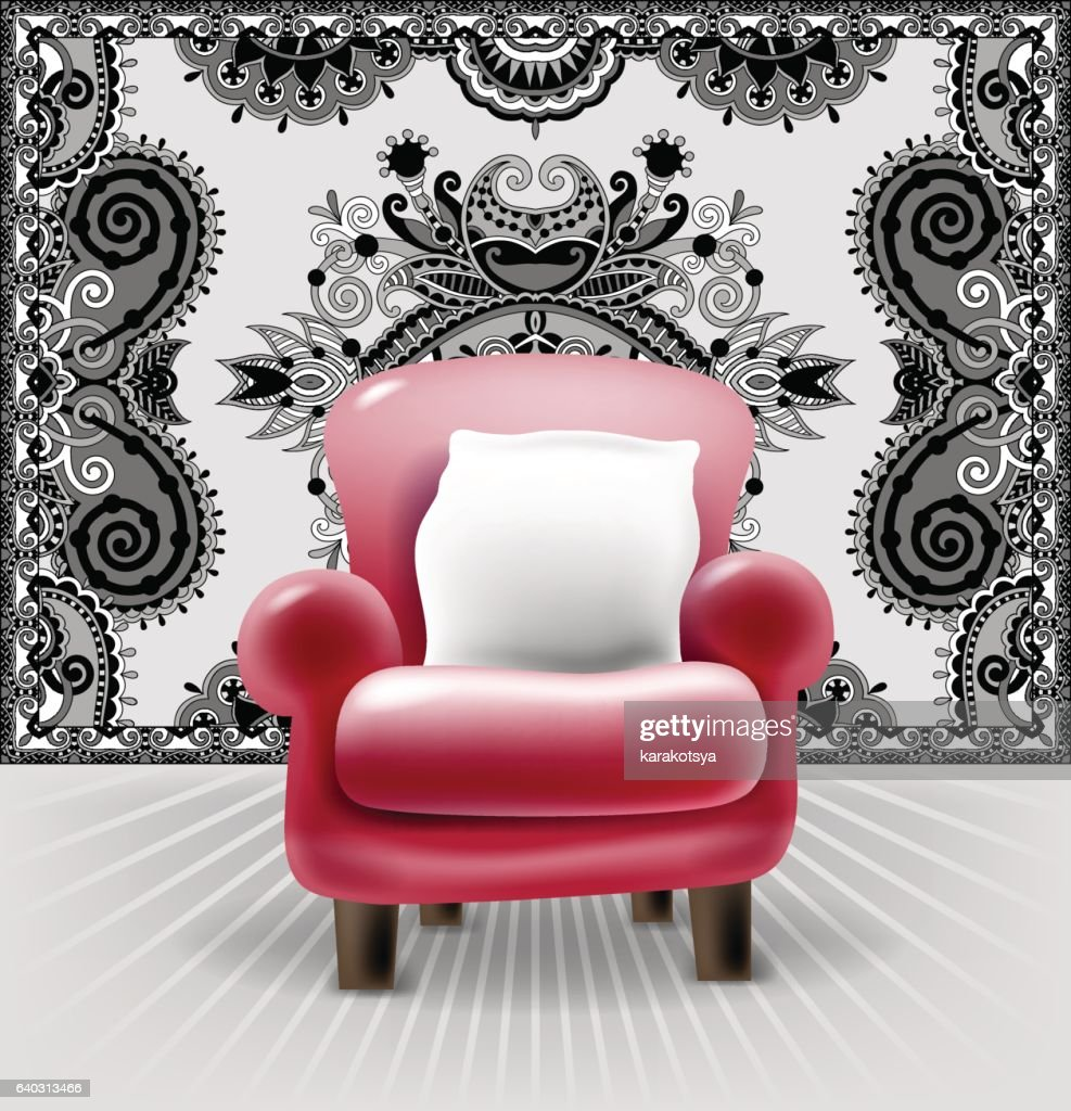 red leather chair with a white pillow in interior
