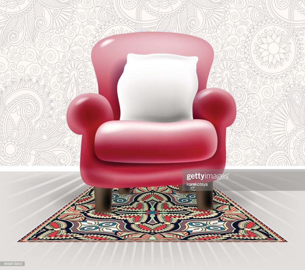 red leather chair with a white pillow in light floral