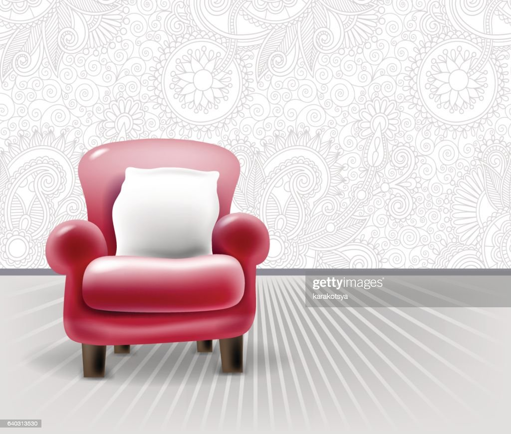 red leather chair with a white pillow in light interior