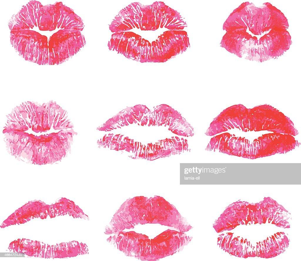 Red lip stick print kisses on white