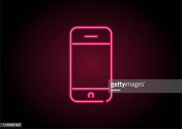 illustrazioni stock, clip art, cartoni animati e icone di tendenza di icona del telefono cellulare rosso neon light on black wall - colore fluorescente
