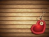 Red Paper Heart Shaped Tag on Wooden Background