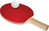 Red ping-pong rackets and white ball