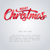 Red ribbon of Merry Christmas calligraphy hand lettering