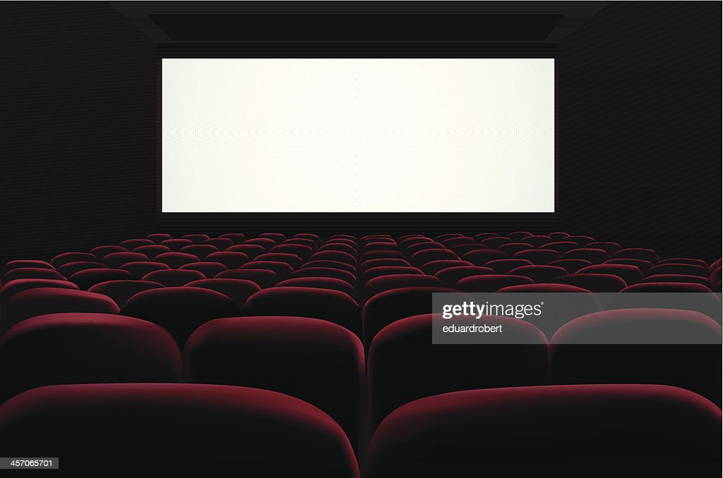 Red seats of cinema in front of blank screen
