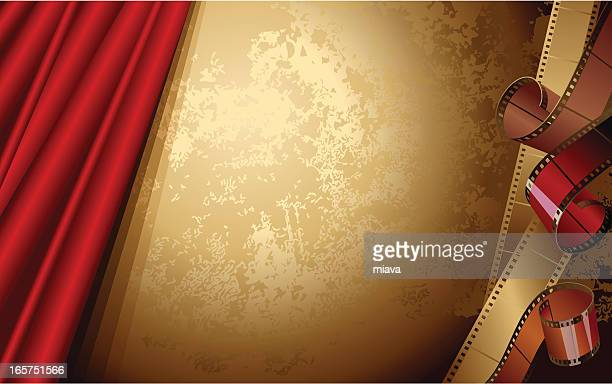 Red theater curtain on a bronze background with film strips