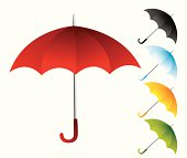 Red umbrella with other colorful umbrellas