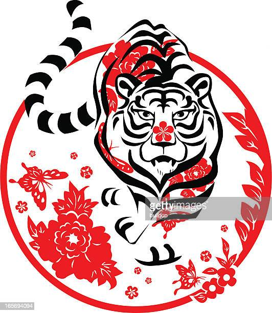 red white and black round year of the tiger icon - tribal art stock illustrations
