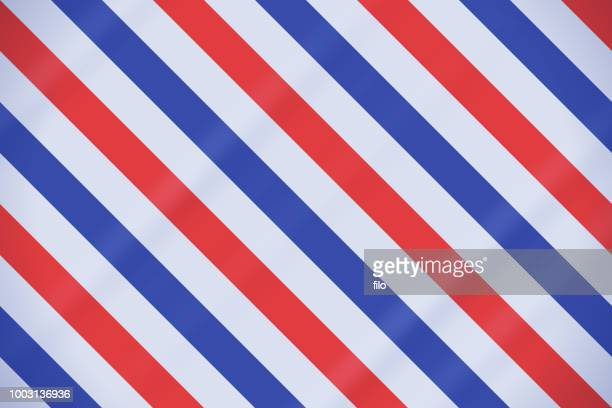 red white and blue patriotic barber pole background - barber pole stock illustrations