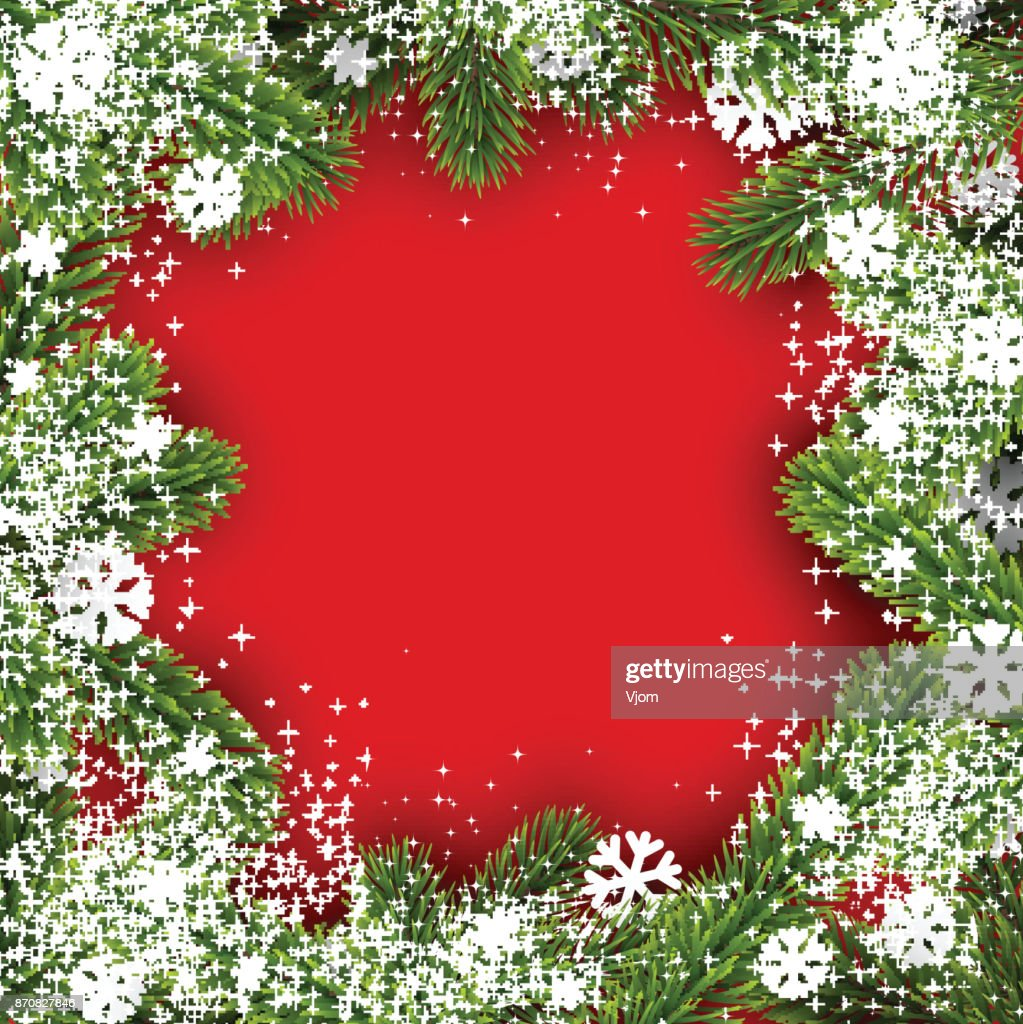 Red winter background with fir branches.