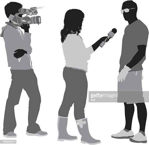 tv reporter taking interview of a man - camera operator stock illustrations, clip art, cartoons, & icons