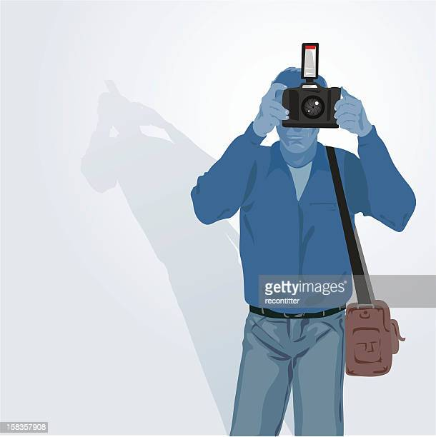 Reporter with camera on neutral background