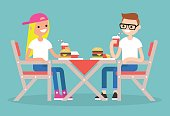 Restaurant visitors. Two teenagers having dinner in a fast food restaurant / flat editable vector illustration, clip art