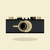Retro camera black and gold. Flat vector illustration. Side view.