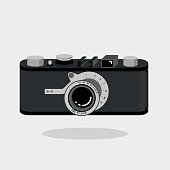 Retro camera black and silver. Flat vector illustration. Isometric perspective.