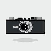 Retro camera black and silver. Flat vector illustration. Side view.