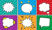 Retro comic empty speech bubbles set on colorful background.