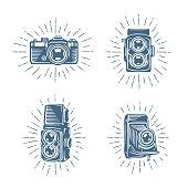 Retro photo cameras set. Hand drawn vector vintage illustration.