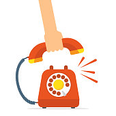 Retro style red telephone ringing. Pick up the phone