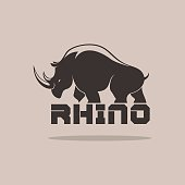 Rhino Silhoulette on a brown background