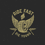 Ride fast die young. Hand drawn wheel with wings. Racer skull.