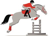 Rider on a horse jumping