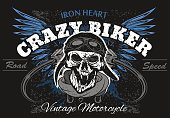 Rider skull with retro racer attributes. Grunge print. Vintage style