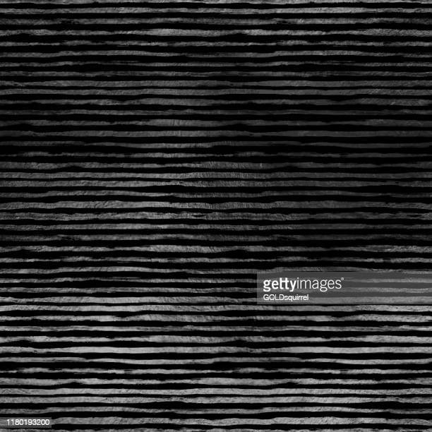 ripped thin strips of silver foil arranged in parallel on a black surface - isolated lines with irregular edges reflecting light - illustration in vector with visible rough texture on the surface - irregular texturizado stock illustrations