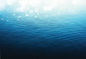 Rippling water with bokeh effect sky