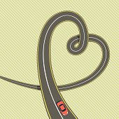 Road in shape of heart with red car