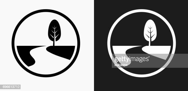 road path and tree icon on black and white vector backgrounds - footpath stock illustrations