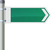 Road sign - green arrow on the pillar.