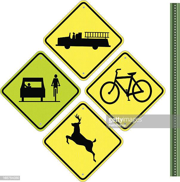 road signs - fire station, deer and bike - animal crossing stock illustrations