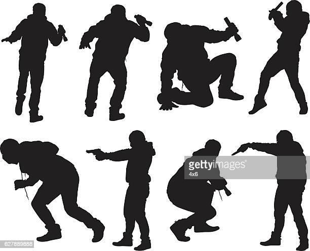robber in action with gun and flash light - handgun stock illustrations