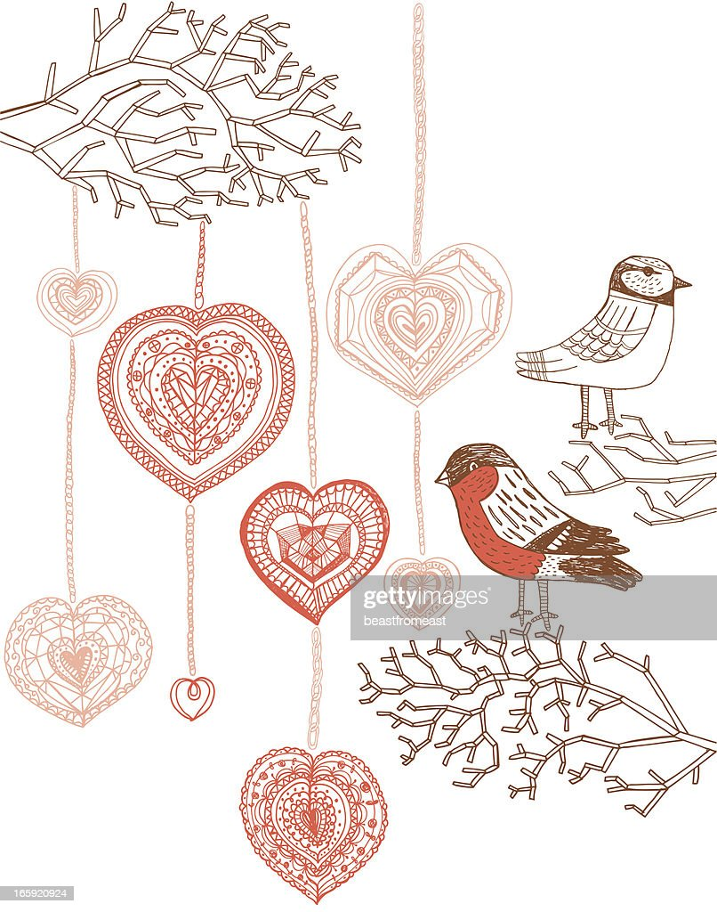 Robin and Bluetit on tree branches decorated with hearts