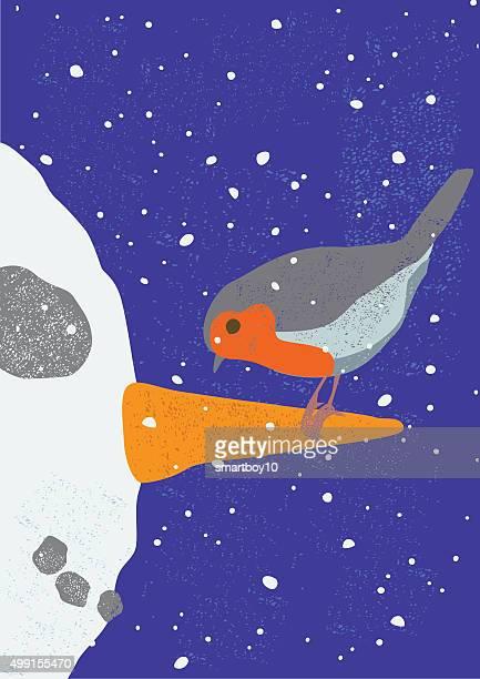 Robin on snowman