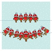 Robins wearing Red Santa Woolly Bobble Hats on Telephone Wires