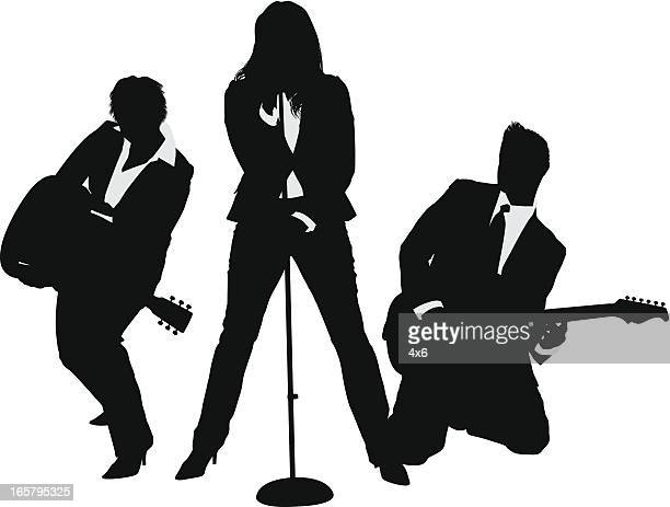 Rock and roll band wearing business suits