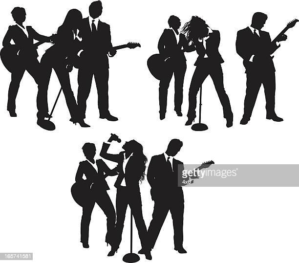Rock and roll group in business suits