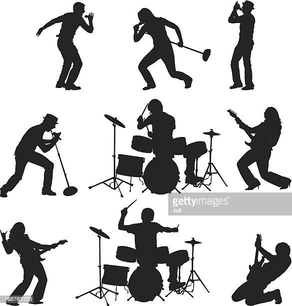 Rock band singing playing guitar and drums