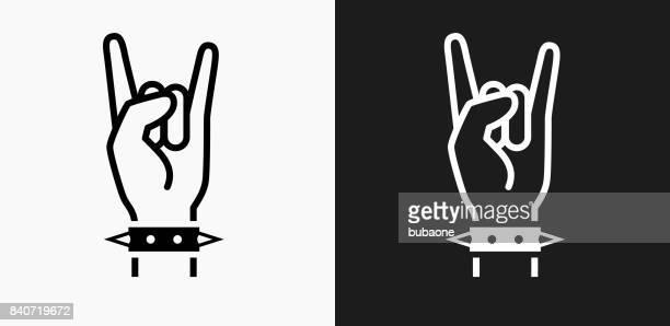 illustrazioni stock, clip art, cartoni animati e icone di tendenza di icona rock su sfondi vettoriali in bianco e nero - musica rock