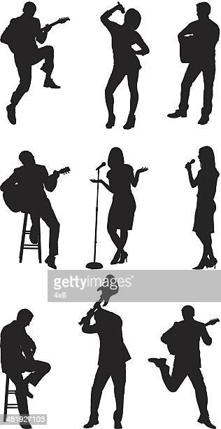 Rock stars singing and playing guitar