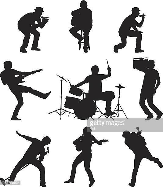rockers on stage playing music - guitarist stock illustrations, clip art, cartoons, & icons