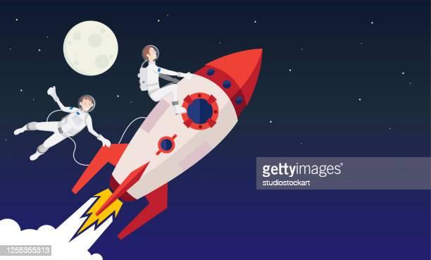 illustrazioni stock, clip art, cartoni animati e icone di tendenza di razzi e astronauti nello spazio - missile razzo spaziale