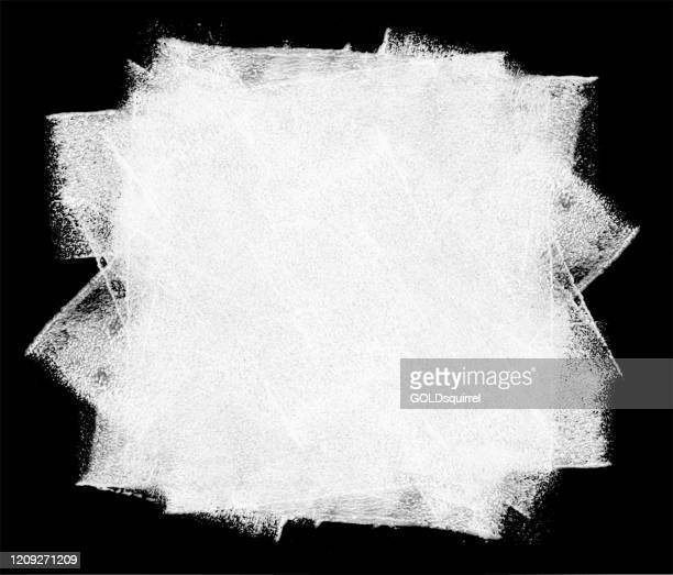 rolled out big stain of white paint on a black background by hand and paint roller - abstract vector illustration with visible uneven irregular wide traces of paint and multilayered effects - paint textures stock illustrations